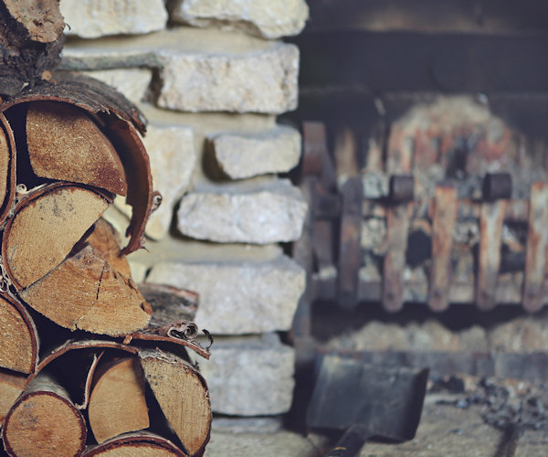 Wood log fire used for chimney sweep web design